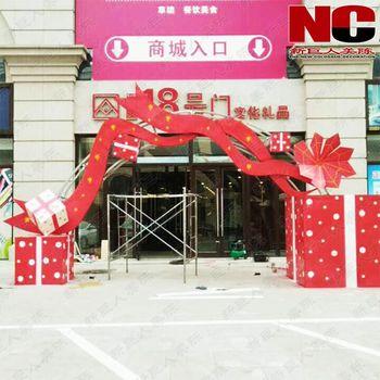 商场装饰新巨人酒店门头dp点空间布置设计八一国庆彩带飘飘新美陈